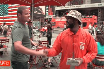 "Schoolboy Q Sells Copies of ""Oxymoron"" In Times Square (Video)"