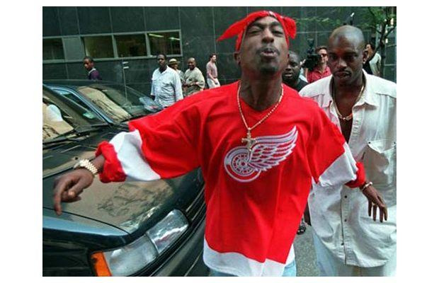 Tupac wearing a Red Wings throwback jersey and his signature bandana headband