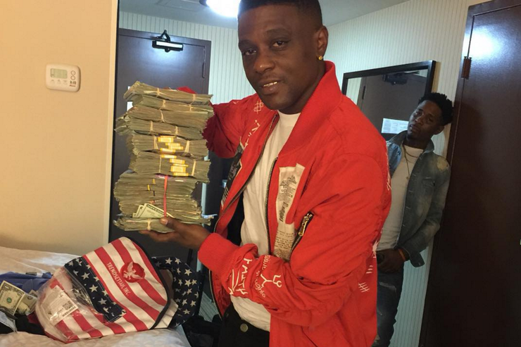 Boosie and stacks of cash