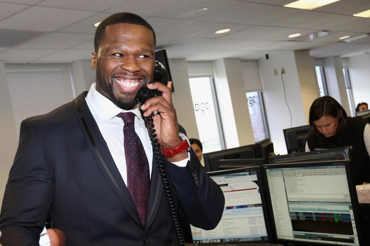 50 Cent on phone at BGC charity