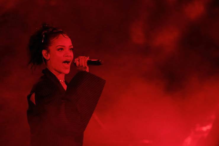 Rihanna performs on stage