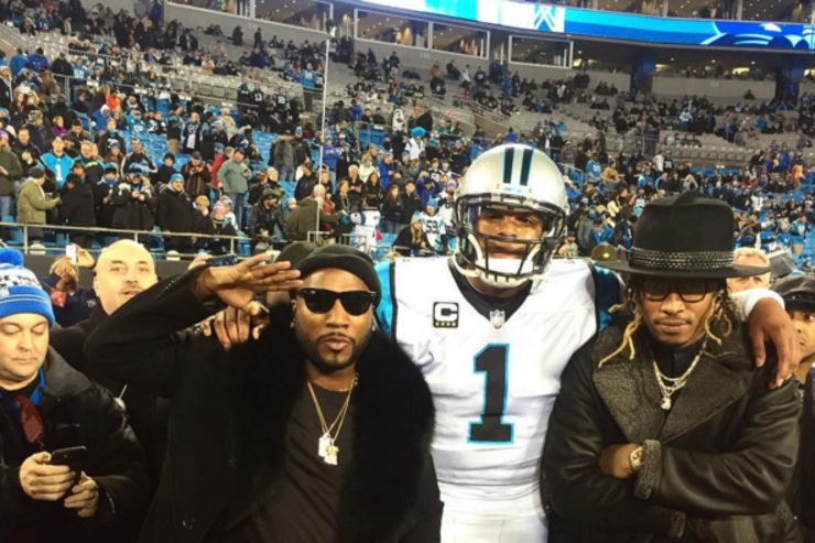 Cam Newton on the field with Future & Jeezy.