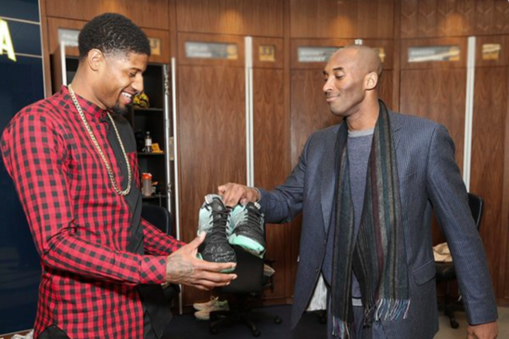 Kobe Bryant and Paul George after the game.