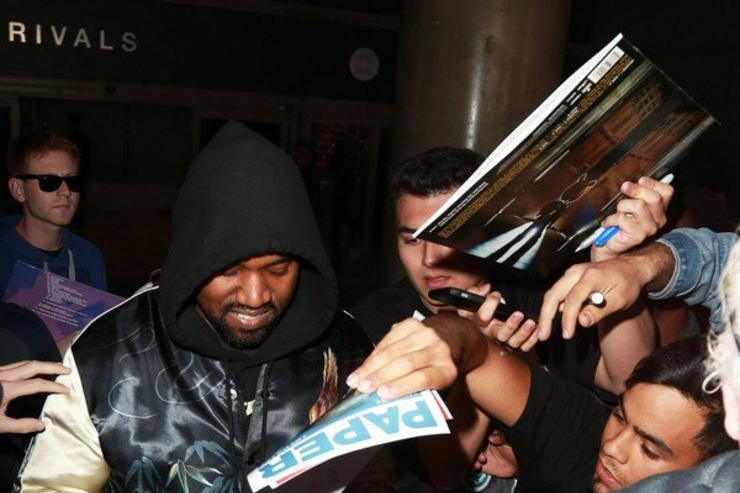 Kanye West signing autograph at LAX