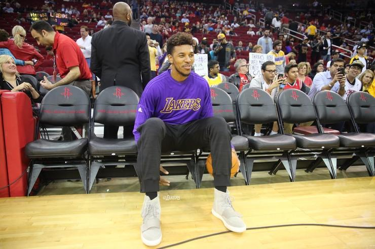 Nick Young warms up before a game