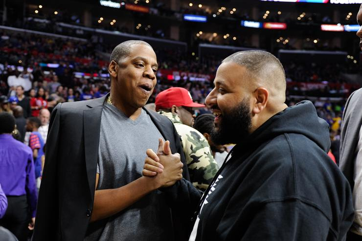 Jay-Z (L) and DJ Khaled attend a basketball game between the Golden State Warriors and the Los Angeles Clippers at Staples Center