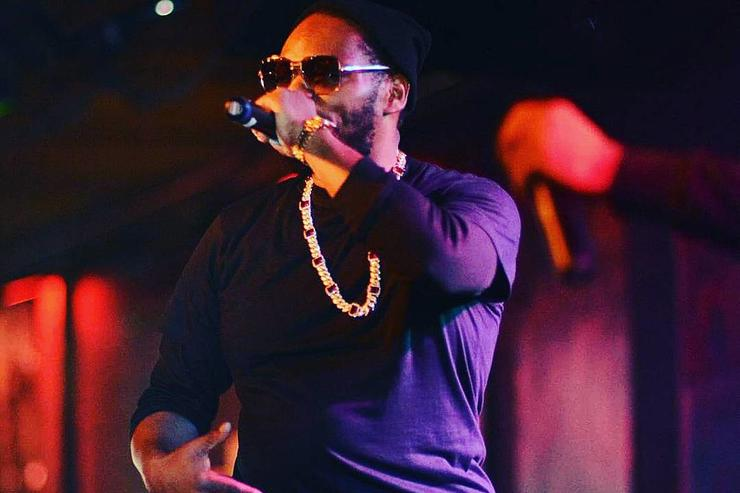 Beanie Sigel performs on stage