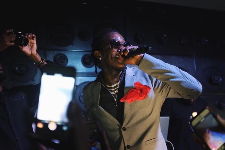 Young Thug performs on stage in Calvin Klein