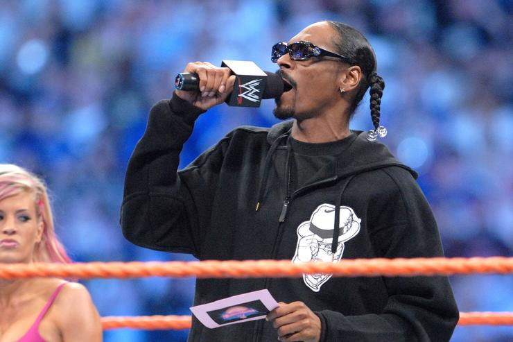 Snoop Dogg is joined by WWE Divas and Playboy cover girls Ashley and Maria at Wrestlemania XXIV at the Citrus Bowl on March 29, 2008 in Orlando, Florida