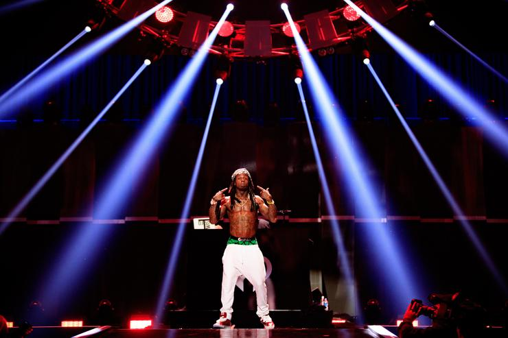 Recodring artist Lil Wayne performs onstage at the 2015 iHeartRadio Music Festival at MGM Grand Garden Arena on September 18, 2015 in Las Vegas, Nevada.