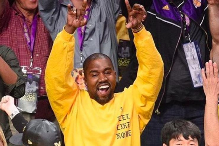 Kanye celebrating at Kobe Bryant's last game