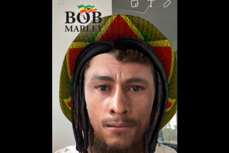A Snapchat user dons the Bob Marley face.