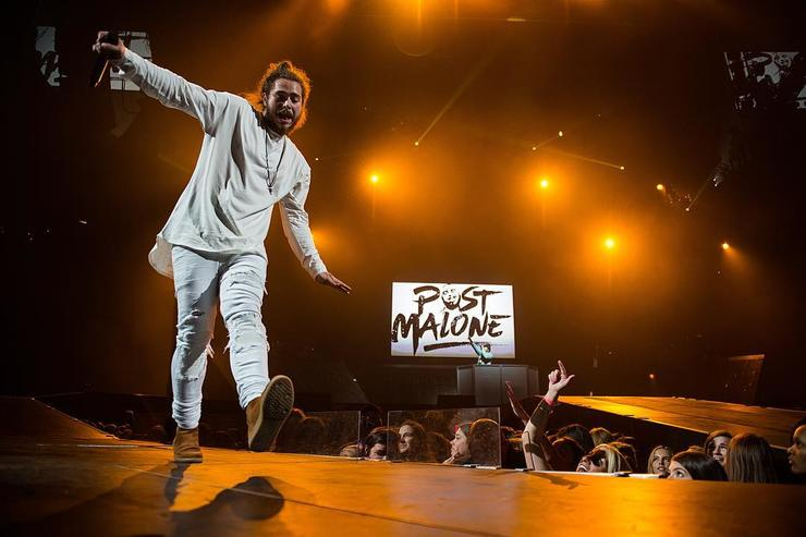 Post Malone performs live.