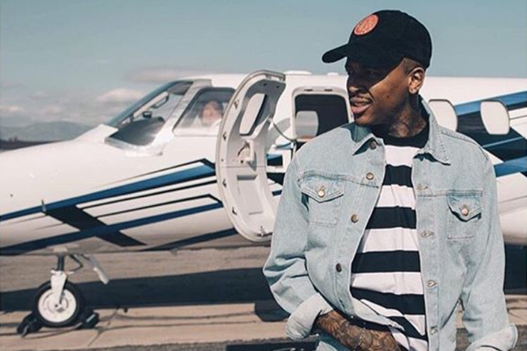 YG next to a private jet