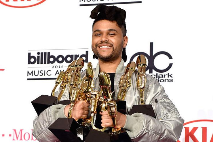 Recording artist The Weeknd, winner of the Top Songs Sales Artist award, Top Radio Song award for 'Can't Feel My Face,' Top Hot 100 Artist award, Top Radio Songs Artist award, Top Streaming Song (Audio) award for 'The Hills,' Top R&B Artist award, and Top R&B Song award for 'The Hills,' poses in the press room during the 2016 Billboard Music Awards at T-Mobile Arena on May 22, 2016 in Las Vegas, Nevada