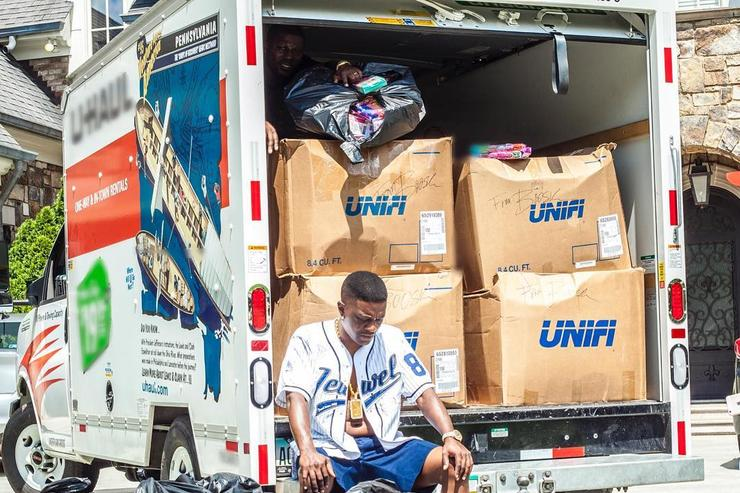 Boosie recuperates after loading clothes into a truck.