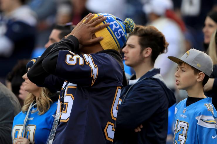 A San Diego Chargers fan looks on during the second half of a game against the Kansas City Chiefs at Qualcomm Stadium on January 1, 2017 in San Diego, California.
