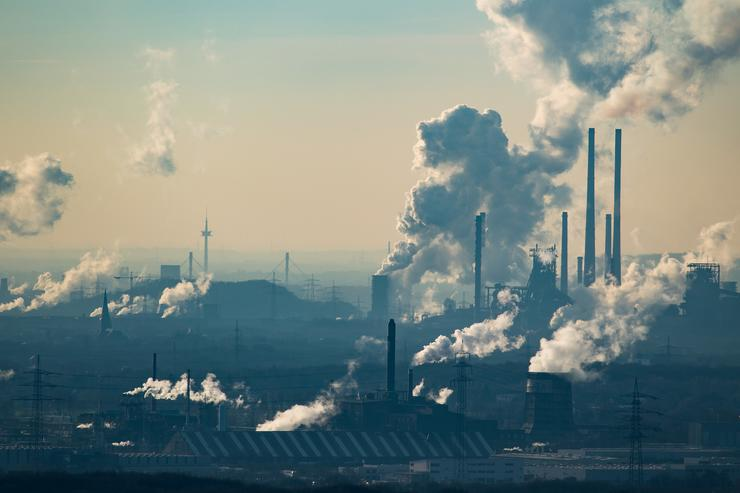 Steam and exhaust rise from the chemical company Oxea (front) and the coking plant KBS Kokereibetriebsgesellschaft Schwelgern GmbH on a cold winter day on January 6, 2017 in Oberhausen, Germany. According to a report released by the European Copernicus Climate Change Service, 2016 is likely to have been the hottest year since global temperatures were recorded in the 19th century. According to the report the average global surface temperature was 14.8 degrees Celsius, which is 1.3 degrees higher than estimates for before the Industrial Revolution. Greenhouse gases are among the chief causes of global warming and climates change.