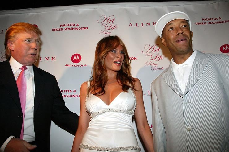Donald Trump, Melania Trump and Russell Simmons during 'Art for Life' Gala Honoring Sean 'P. Diddy' Combs Hosted by Russell Simmons and Kimora Lee Simmons at Mar-a-Lago in Palm Beach, Florida, United States.
