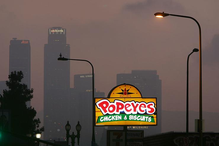 Popeyes fast-food restaurant sign glows above the city skyline on July 24, 2008 located in the Figueroa Corridor area of South Los Angeles, Los Angeles, California. The Los Angeles City Council committee has unanimously approved year-long moratorium on new fast-food restaurants in a 32-square-mile area, mostly in South Los Angeles, pending approval by the full council and the signature of Mayor Antonio Villaraigosa to make it the law. South LA has the highest concentration of fast-food restaurants of the city, about 400, and only a few grocery stores. L.A. Councilwoman Jan Perry proposed the measure to try to reduce health problems associated with a diet high in fast-food, like obesity and diabetes, which plague many of the half-million people living there.