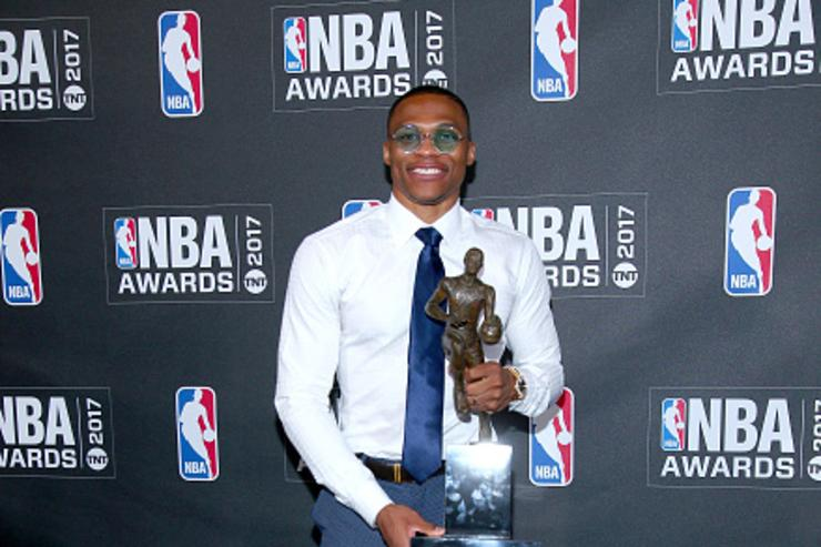 Russell Westbrook with NBA MVP trophy