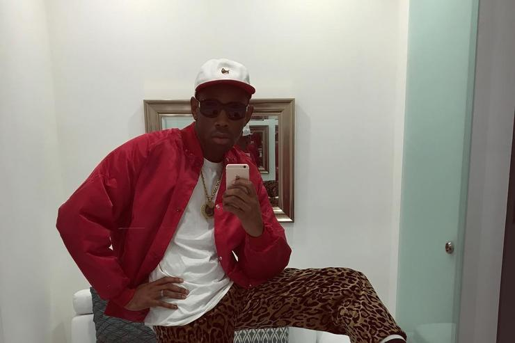 Tyler The Creator taking a bathroom selfie